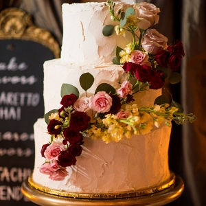 Fresh flower cascade on textured three tiered cake