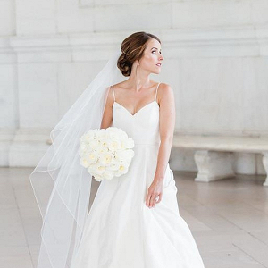 Bride in chic spaghetti strap gown