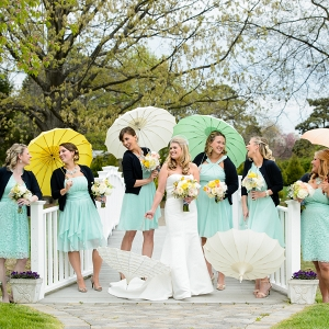 rainy day bridesmaid portrait session with colorful umbrells