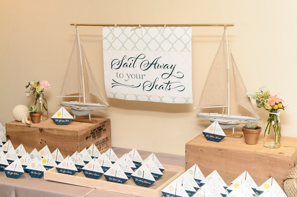 Sail away escort cards as origami boats