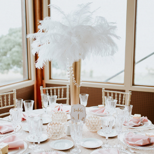 Maryland Gatsby Wedding - feather gold centerpiece